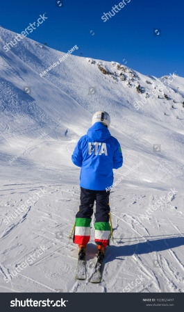 stock-photo-unidentifiable-female-skiier-from-behind-with-a-jacket-written-ita-which-is-short-for-italy-and-1028624497