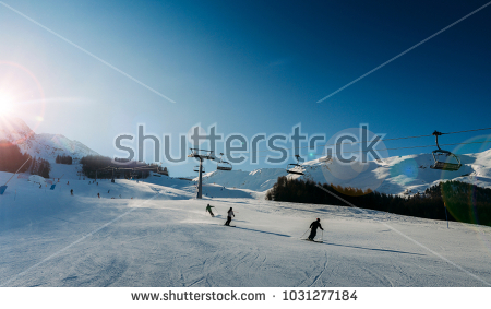 stock-photo-unidentifiable-skiers-at-ski-resort-in-pila-valle-d-aosta-italy-with-chairlift-and-mountain-1031277184