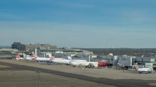 London Gatwick, March 15th, 2018: Airplanes of different airliners on tarmac awaiting passengers at London Gatwick's North Terminal