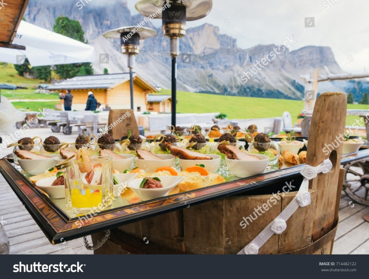 stock-photo-aperitivo-overlooking-the-dolomites-mountain-range-in-south-tyrol-northern-italy-714482122