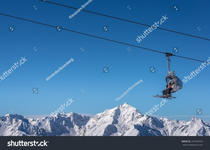 stock-photo-chair-lift-used-by-skier-in-winter-247405033