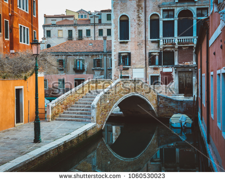 stock-photo-colorful-bridge-across-canal-in-venice-italy-1060530023