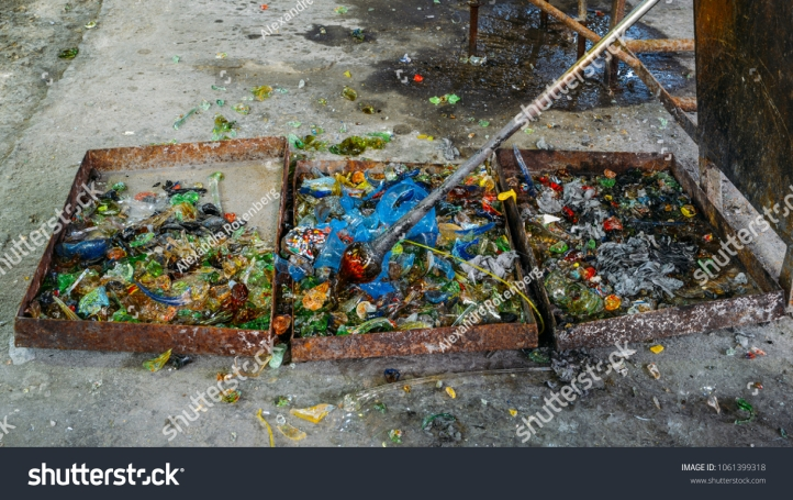 stock-photo-glass-blower-instruments-and-crushed-glass-of-different-colours-in-a-workshop-1061399318