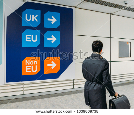 stock-photo-london-gatwick-march-nd-passenger-walks-past-sign-prior-to-immigration-control-pass-a-sign-1039609738