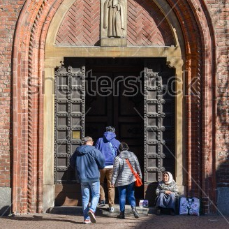 stock-photo-milan-italy-april-st-an-elderly-woman-begs-in-front-of-a-church-1069628645