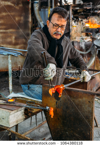 stock-photo-murano-italy-march-th-a-man-works-on-a-glass-piece-using-a-hot-furnace-in-a-workshop-1064380118