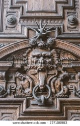 stock-photo-scary-halloween-wooden-door-with-gargoyles-727106983