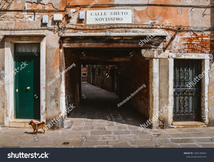 stock-photo-venice-italy-march-entrance-to-an-ancient-alleyway-in-the-traditional-jewish-ghetto-of-1062189461