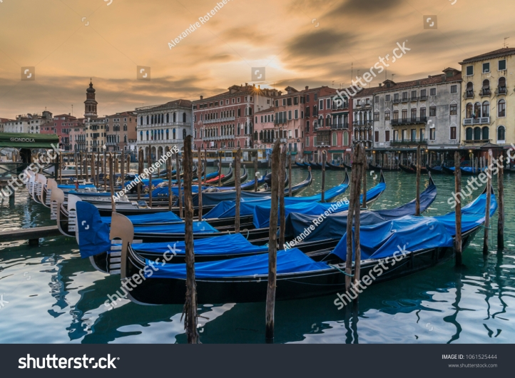 stock-photo-venice-italy-march-moored-gondolas-on-the-canal-grande-in-venice-italy-1061525444