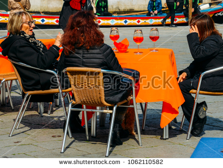 stock-photo-venice-italy-march-older-women-enjoying-a-cocktail-drink-on-a-terrace-1062110582