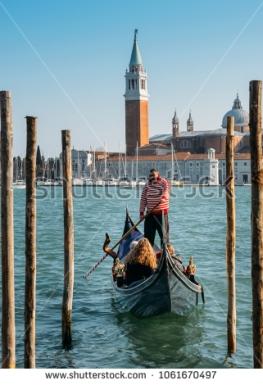 stock-photo-venice-italy-march-tourists-enjoy-a-gondola-ride-in-venice-italy-1061670497