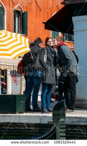 stock-photo-venice-italy-march-young-couple-in-romantic-venice-1061525441