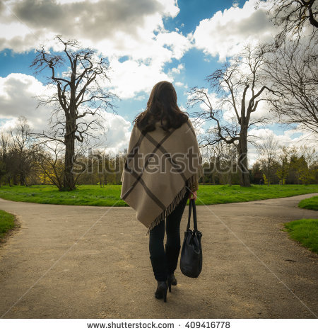 stock-photo-woman-making-tough-life-decisions-on-fork-in-road-409416778