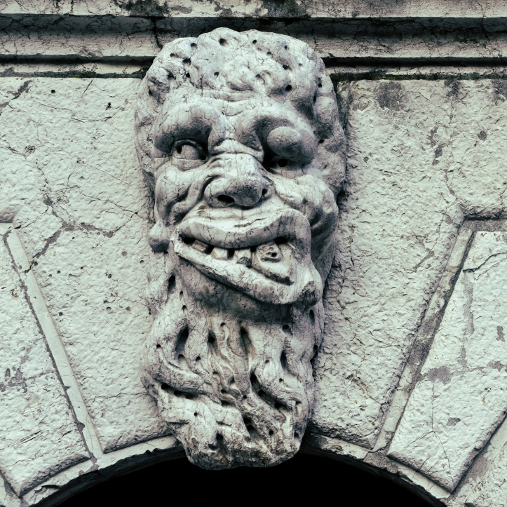 Grotesque Face of a monster sculpture on a Church in Venice