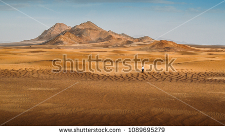 stock-photo-a-man-walking-alone-in-the-dasht-e-lut-a-large-salt-desert-located-in-the-provinces-of-kerman-1089695279