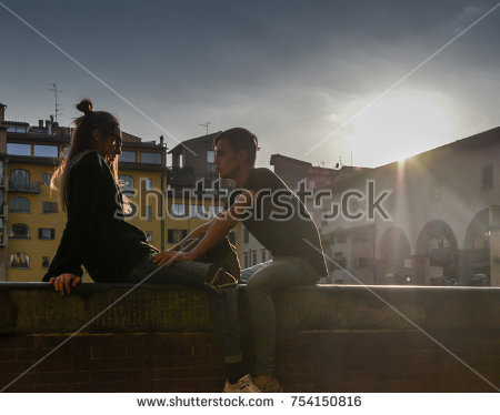 stock-photo-florence-italy-october-th-silhouette-of-young-couple-next-to-ponte-vecchio-in-florence-754150816