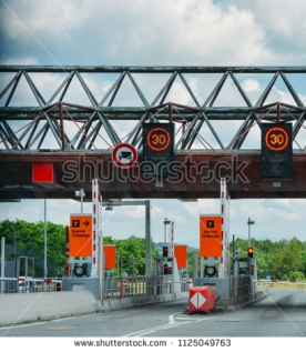 stock-photo-southwest-france-june-cars-passing-through-the-point-of-toll-highway-toll-station-in-1125049763