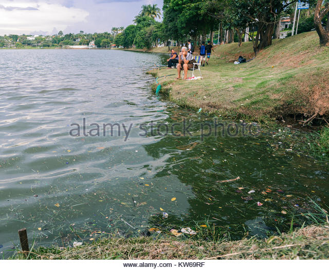 belo-horizonte-dec-26-2017-afro-brazilian-women-fish-on-pampulha-lake-KW69RF