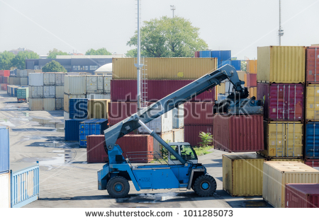 stock-photo-a-truck-picks-up-a-container-for-import-export-business-1011285073
