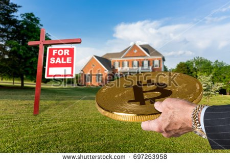stock-photo-businessman-or-finance-executive-in-suit-offering-bitcoin-to-purchase-large-single-family-home-697263958
