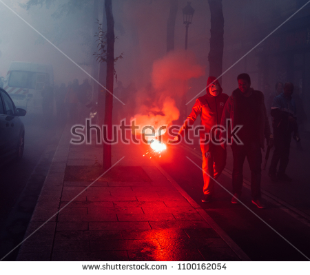 stock-photo-paris-france-may-protestors-wearing-a-guy-fawkes-mask-light-gas-canisters-to-express-1100162054