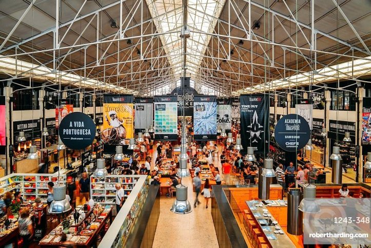 Time Out Market is a popular food hall located in Mercado da Ribeira at Cais do Sodre in Lisbon, Portugal