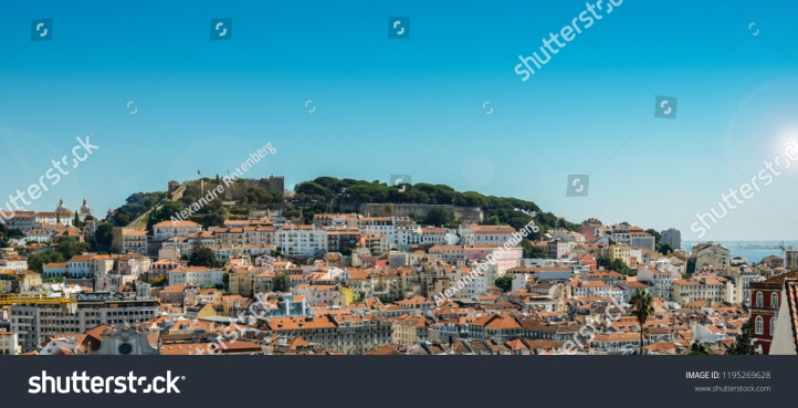 stock-photo-panoramic-view-over-the-center-of-lisbon-from-the-viewpoint-called-miradouro-de-sao-pedro-de-1195269628