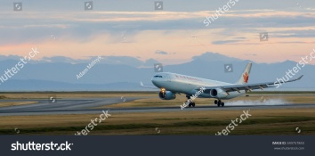 stock-photo-vancouver-bc-canada-july-an-air-canada-a-touching-down-on-yvr-s-runway-l-349757843
