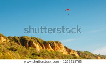 one-man-gliding-using-parachute-450w-1222615765