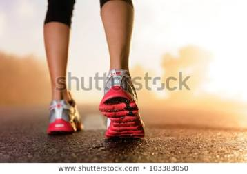 runner-feet-running-on-road-450w-103383050