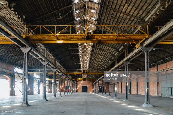 Old and dusty warehouse with light coming through openings