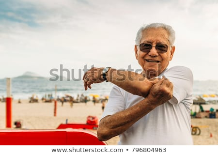 older-man-8085-stretching-his-450w-796804963