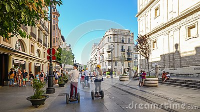 seville-spain-july-th-tourists-segways-av-de-la-constitucion-historic-centre-andalusia-123902970