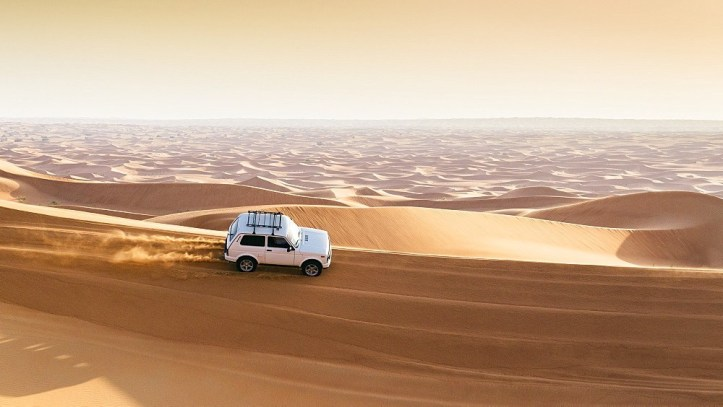 Offroad vehicle on sand dunes near Dubai in the United Arab Emirates