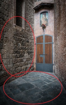Narrow medieval entrance with virgin Mary mural in Siena, Tuscany, Italy