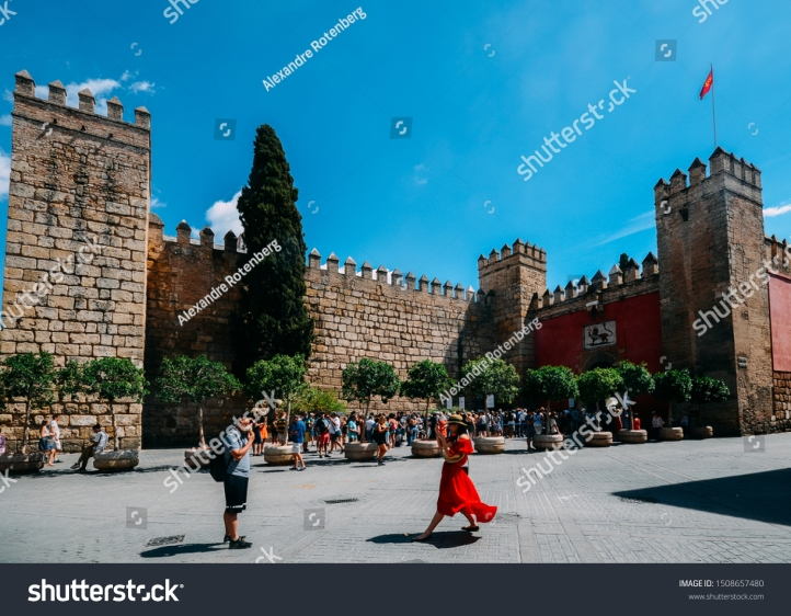 stock-photo-seville-spain-sept-tourists-take-pictures-and-others-queue-to-enter-the-landmark-1508657480
