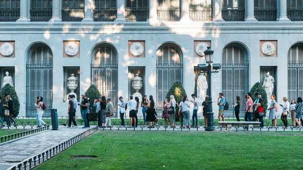 Tourists queue at the entrance of the Prado Museum in Madrid, Spain