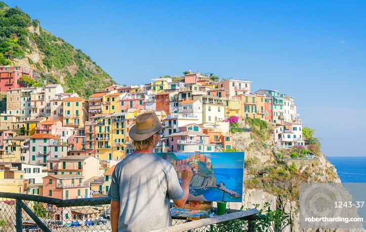 A painter at Manarola, Cinque Terre, Italy