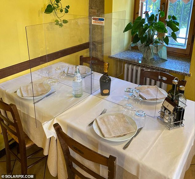 27236198-8221339-Plexiglass_pictured_in_restaurant_is_hoped_to_be_a_possible_solu-a-6_1586976398401