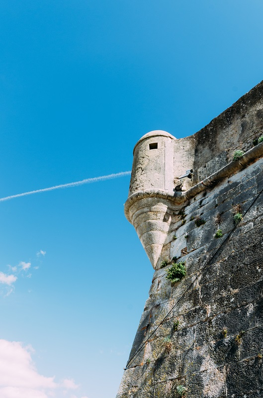 Detail of the old rampart wall and watchtower of the 16th century Citadel of Cascais Portugal with modern surveillance