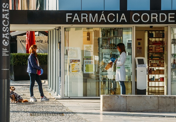 Customer and pharmacist outside a pharmacy in Cascais, Portugal during the Coronavirus Covid-10 epidemic