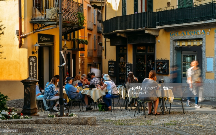 Bellagio, Italy - April 26, 2018: Tourists sitting at a cafe
